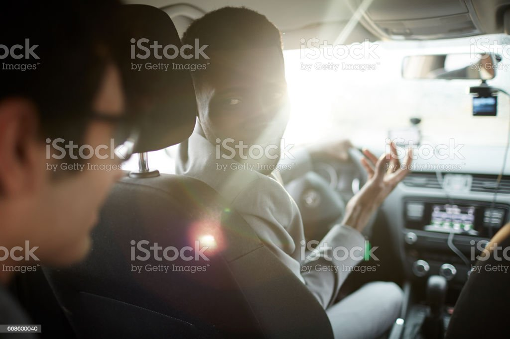 Talking to Driver in Car stock photo