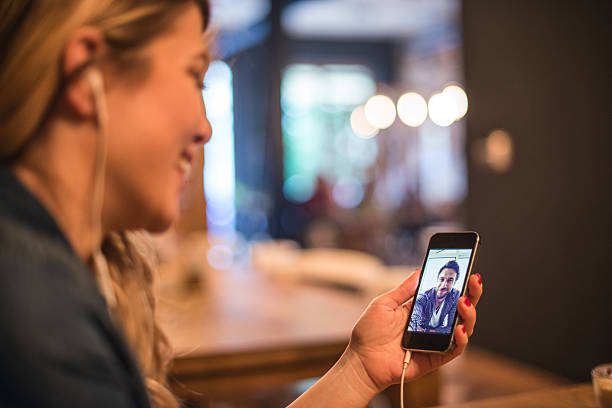 talking to her boyfriend - video call bildbanksfoton och bilder