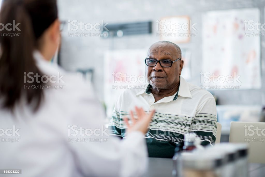 Talking To His Doctor stock photo