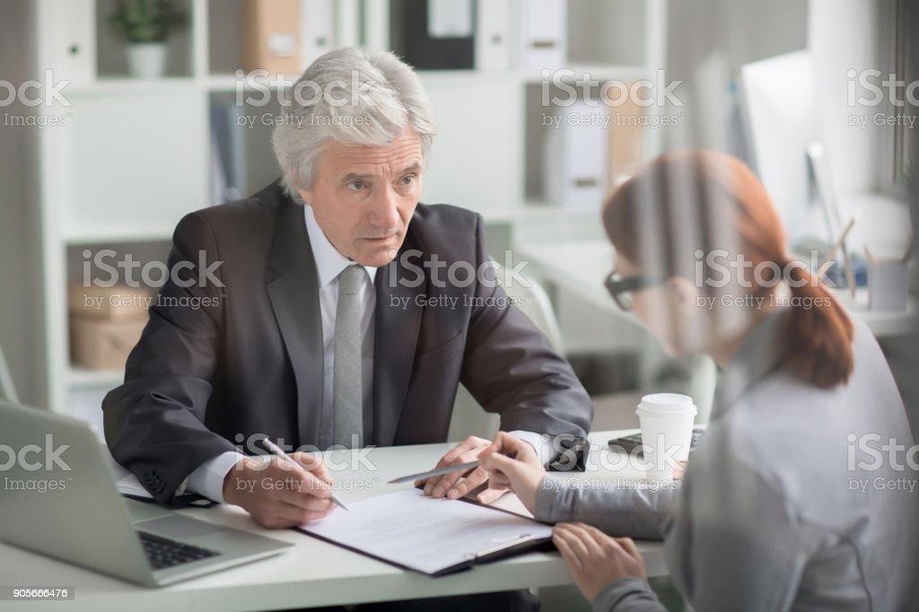 Talking to secretary stock photo