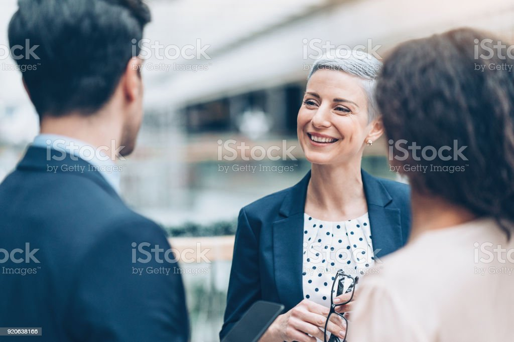 Talking with the colleagues stock photo