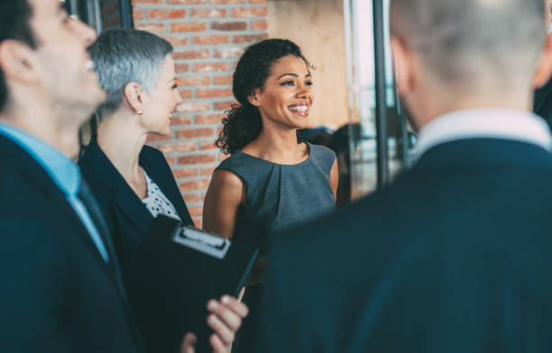 talking with the colleagues - woman suit stock photos and pictures