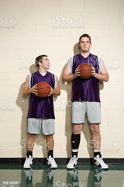 Photo of Tall and short basketball players