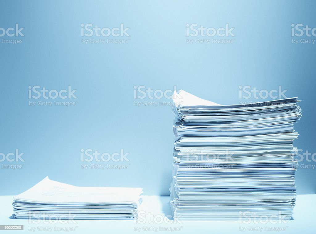 Tall and short stacks of paper stock photo