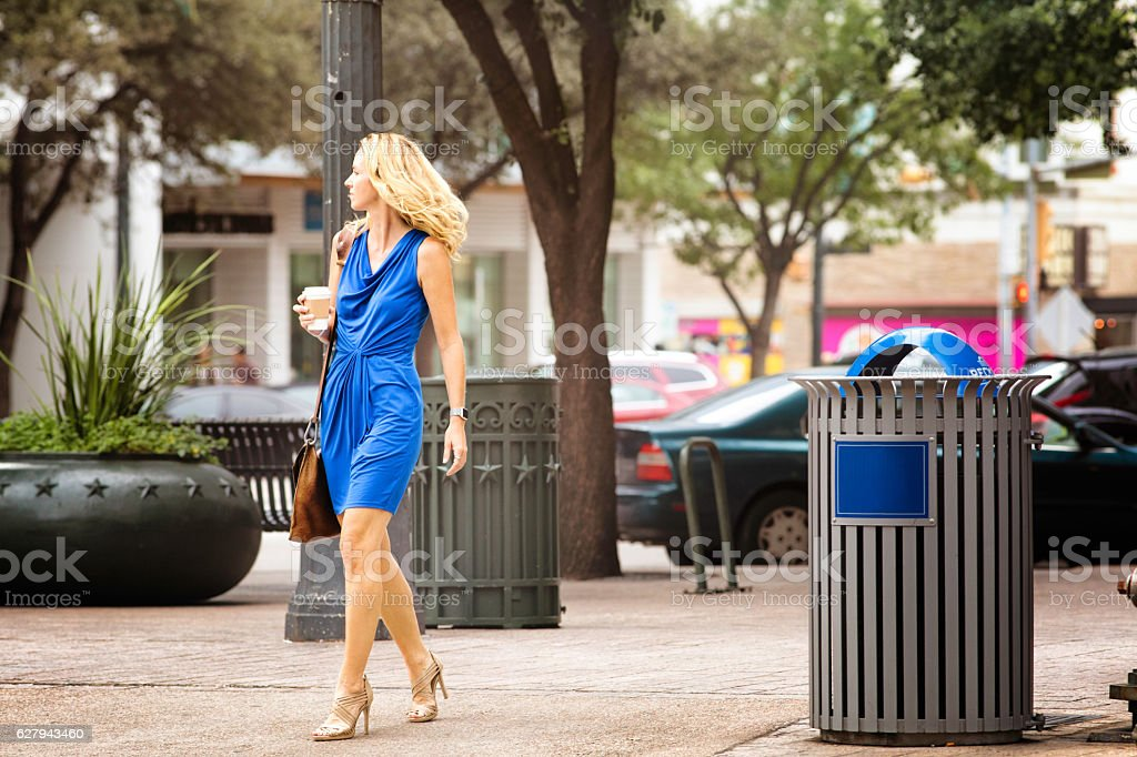 Tall Athletic woman about to cross the street stock photo