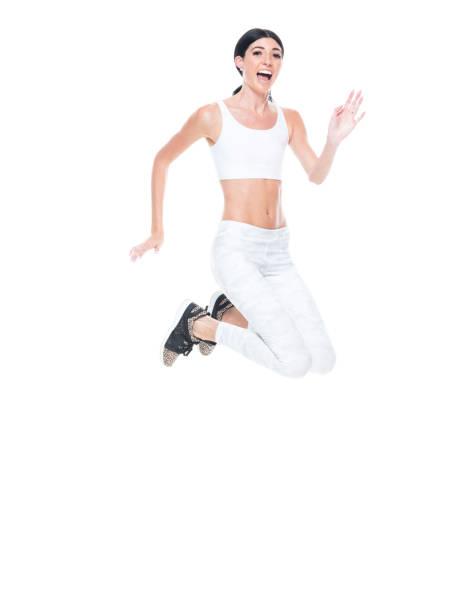 groß schöne weibliche sportbekleidung-laufen und springen - damen hosen größe 27 stock-fotos und bilder