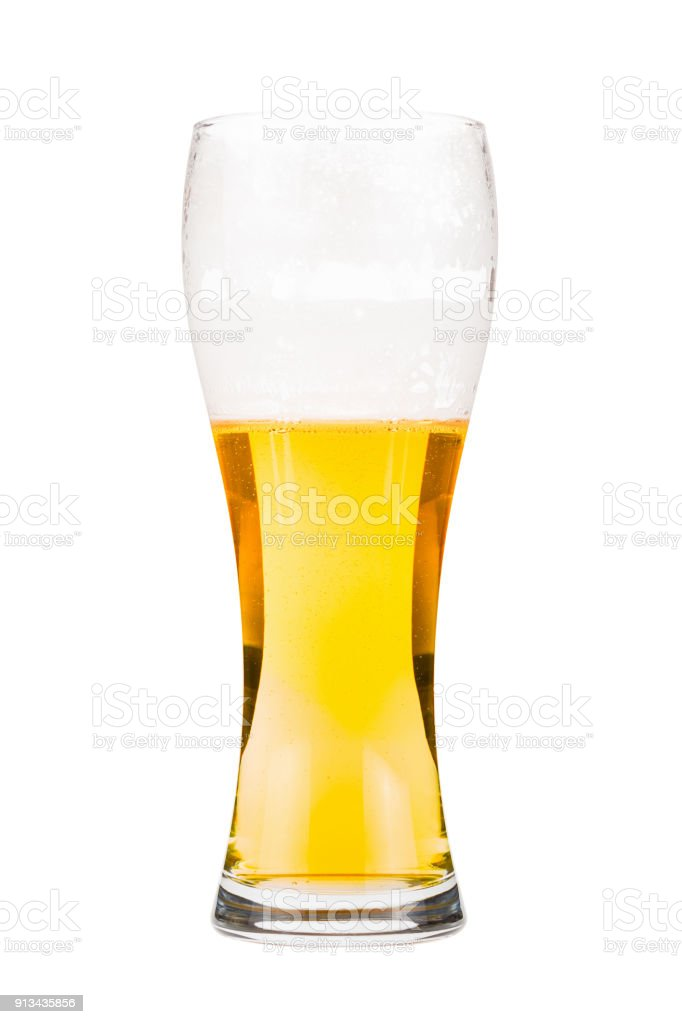 Tall beer glass almost full with lager beer stock photo