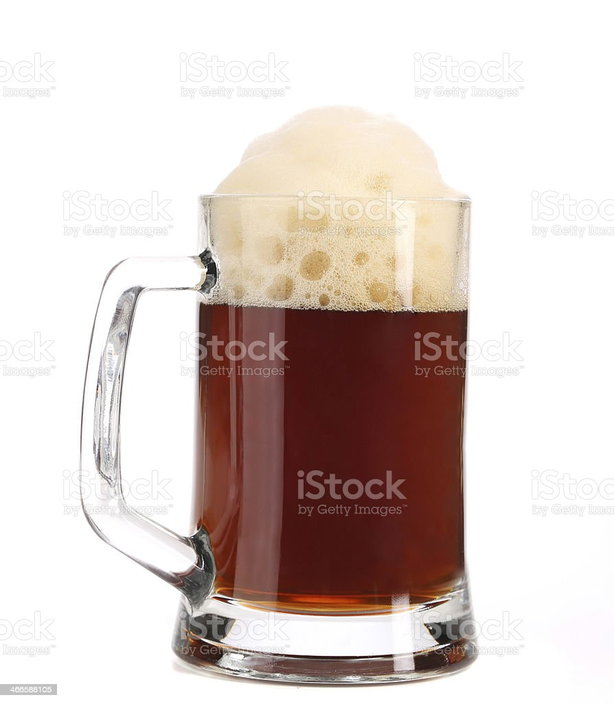 Tall big mug of brown beer with foam. stock photo