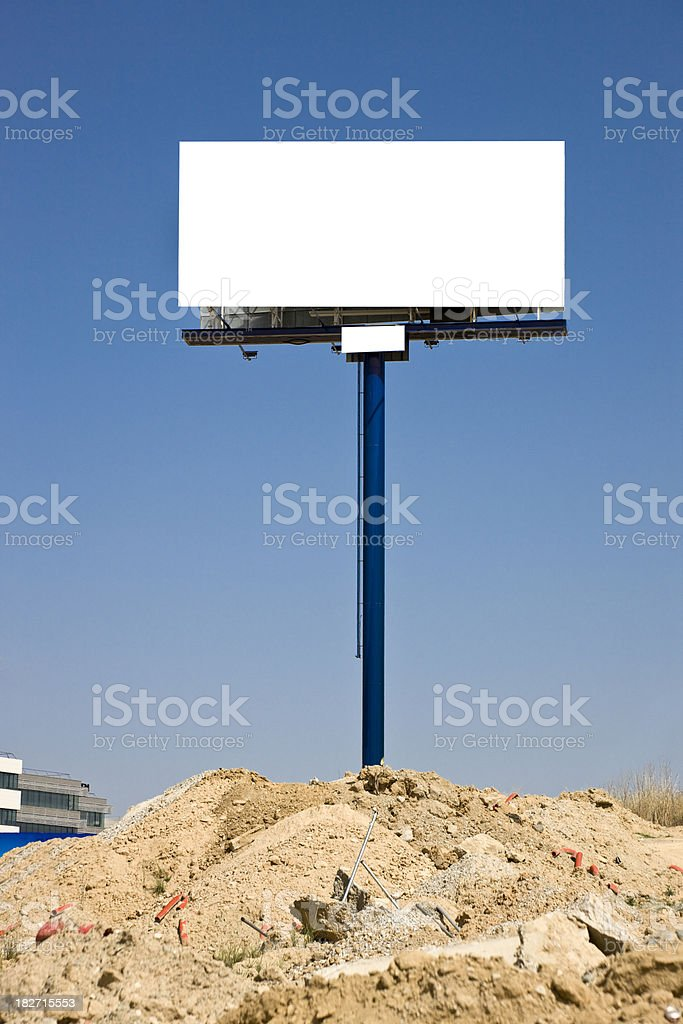 Tall billboard over rubble. royalty-free stock photo
