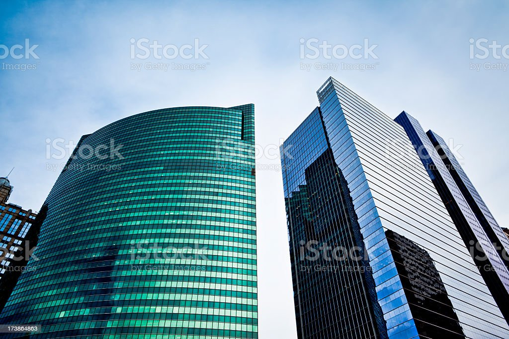 Tall blue and green corporate skyscrapers royalty-free stock photo