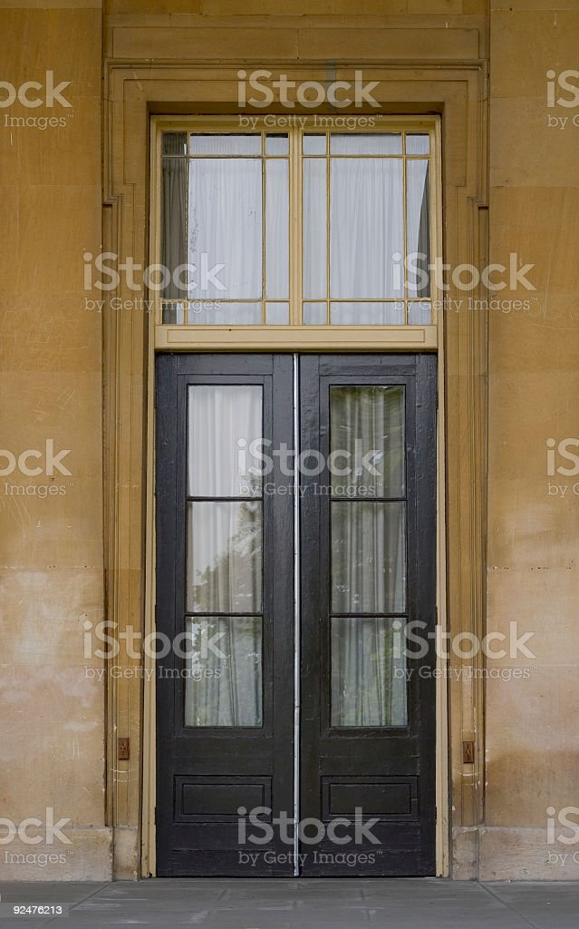 Tall brown doors royalty-free stock photo