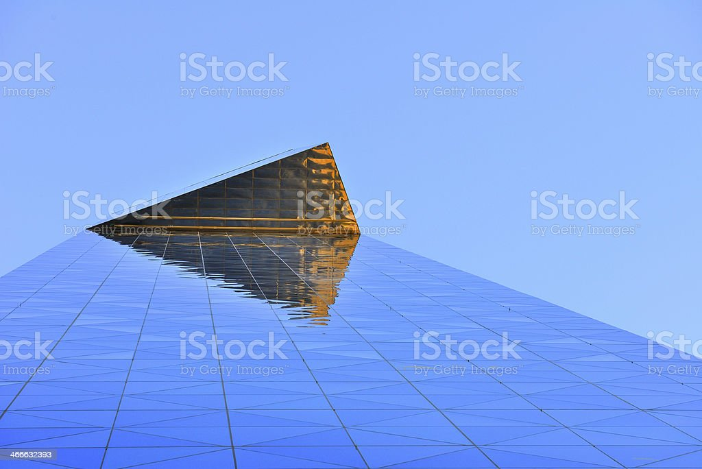 Tall building reflecting sky, sunset stock photo