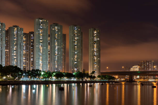 Tall buildings and water reflection at night – zdjęcie