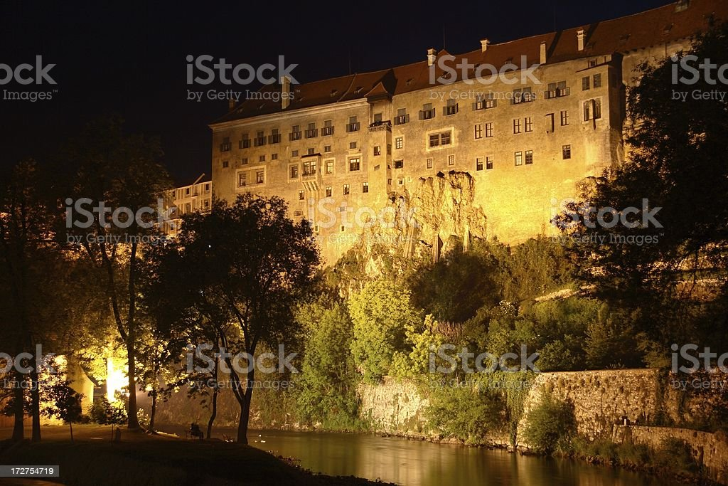 Tall castle walls at night stock photo