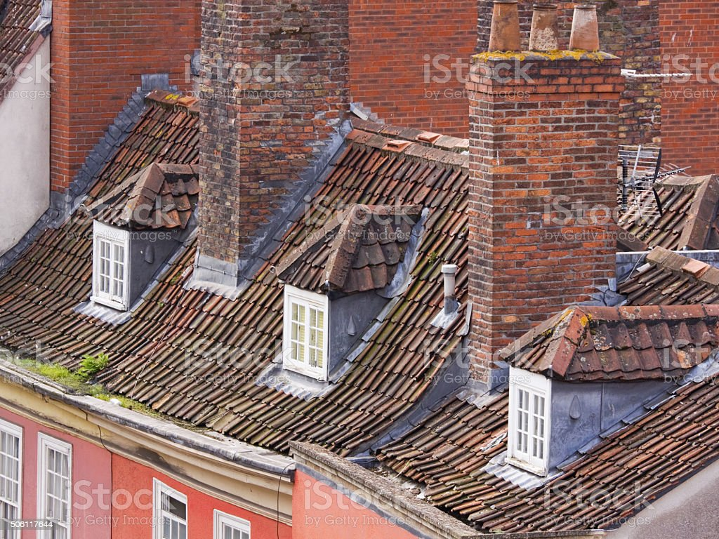 Tall chimney stacks and slated rooftops of old buildings UK stock photo