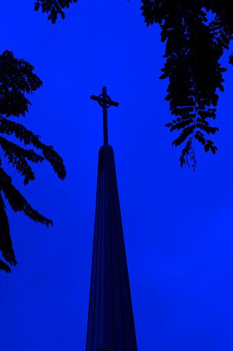 Close up Cross of church at night in Deerfield Beach, Florida.
