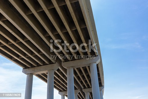 city road,flyover,engineering,outdoor,road,curve,freeway,viaduct,building,highway,cement,pillars,transport,load bearing,transportation,logistics,business,the bottom of the bridge,the support,architecture,sky,bridge,blue,construction,city,tower,office,concrete,structure,tall,pillar,glass,house,column,exterior,steel,windows,urban,design,window,overpass,modern,travel,angle,view,high,background,abstract,commerce,and the bottom