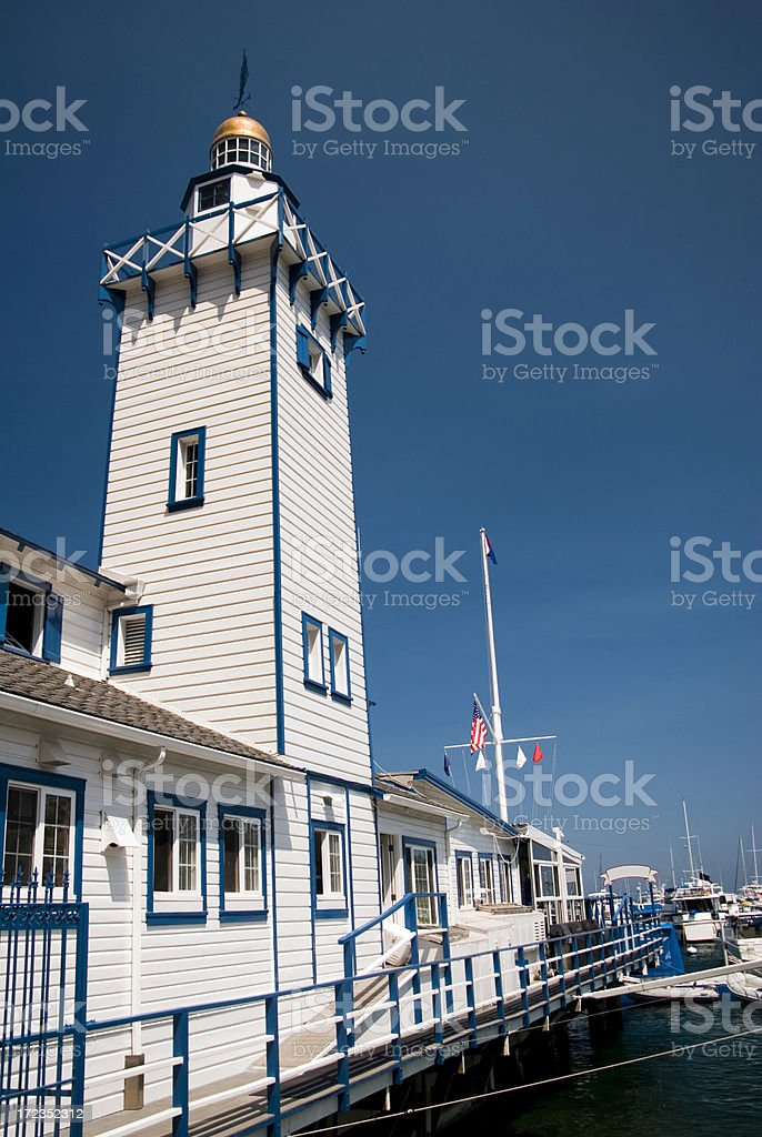 Tall lighthouse on the water royalty-free stock photo