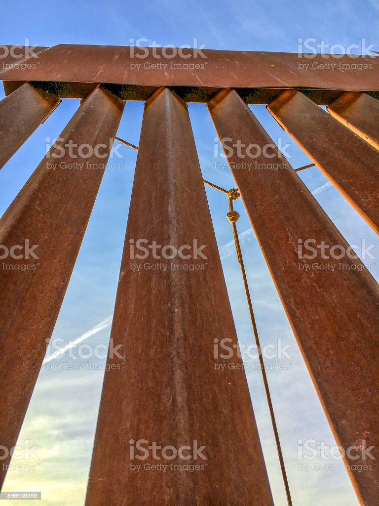 Tall metal fence stock photo