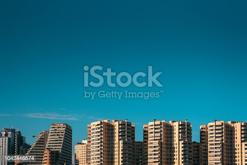 Tall, modern apartment buildings in Valencia, Spain, with copy space in the clear blue sky