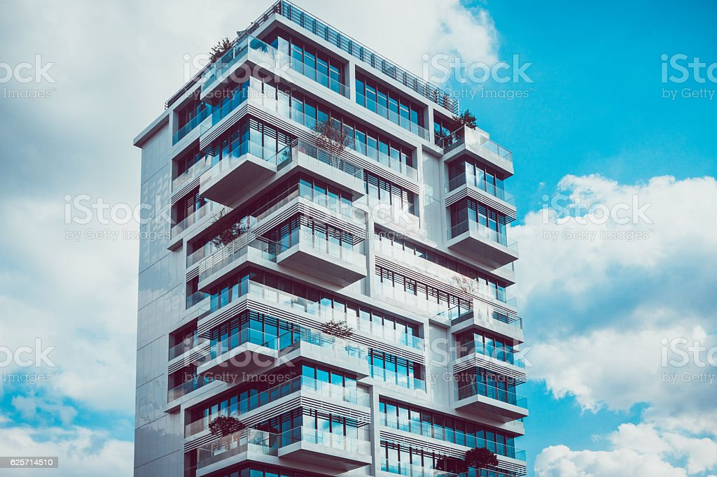 Tall modern condominiums with intersecting levels stock photo