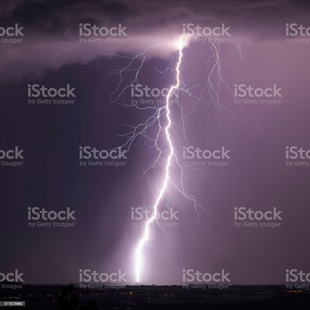 Tall negative cloud to ground lightning stock photo