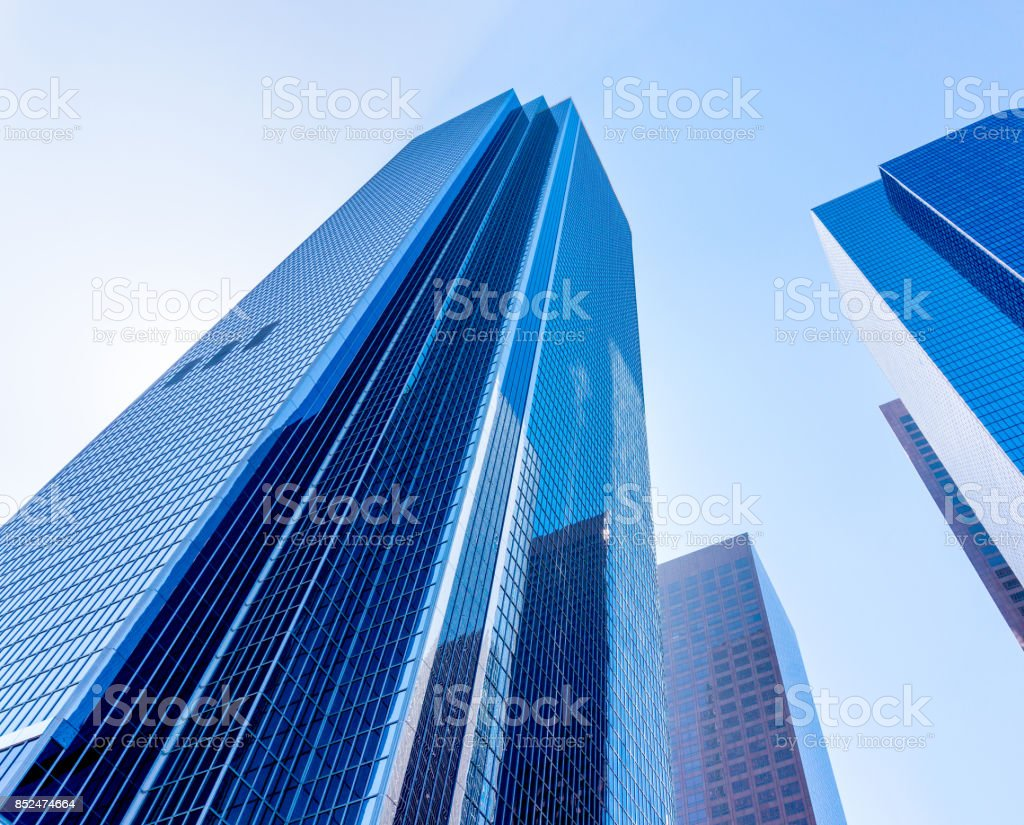 Tall office buildings view from down on the ground. High skyscrapers in a city. stock photo