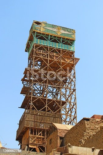 A tall pigeon  tower on the rooftop of a building in Cairo