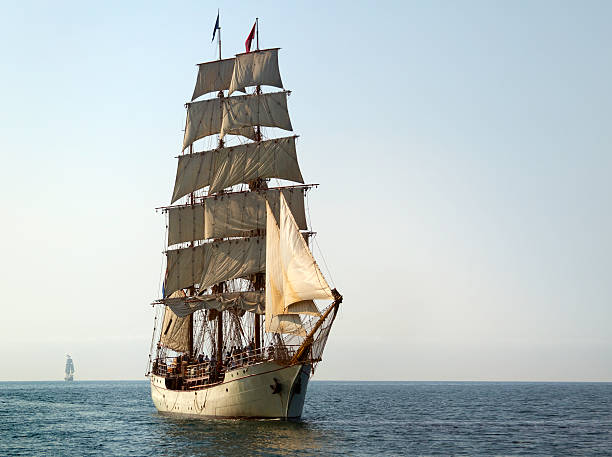 tall ship at sail on sunny morning - vintage nautical stock photos and pictures