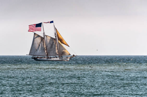 Tall ship at sea with large US American flag stock photo