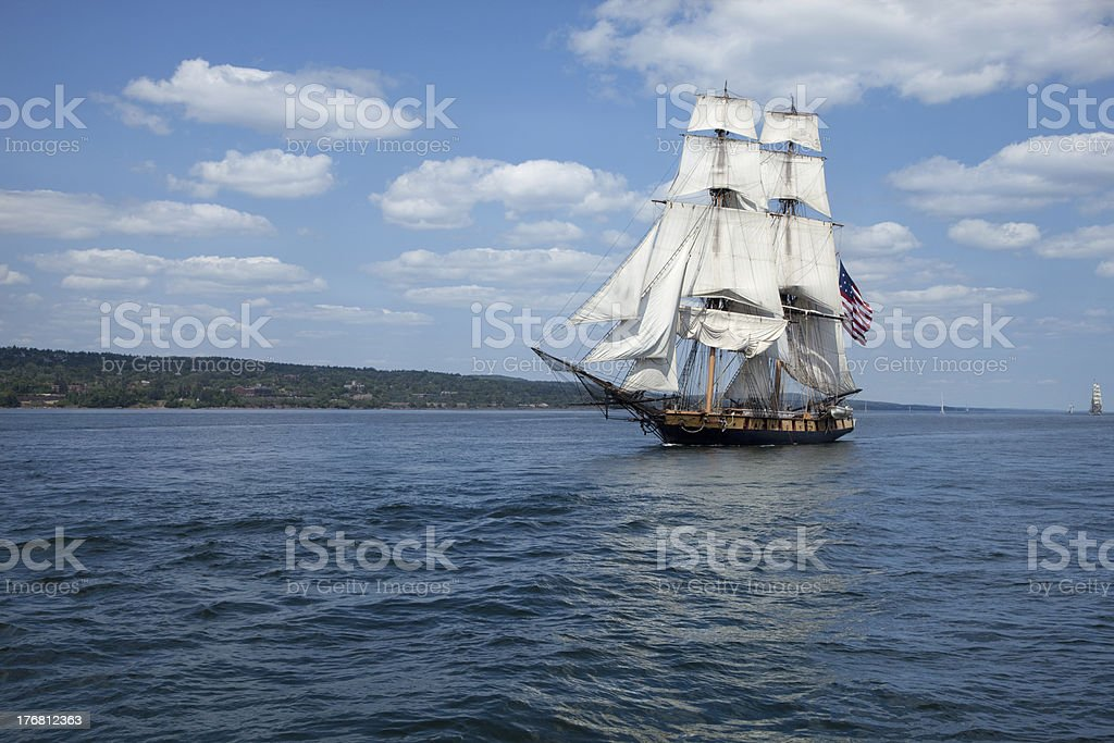 Tall ship on blue waters flying American flag stock photo