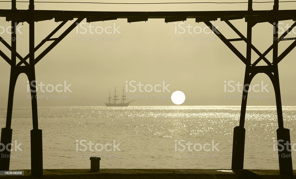 Tall Ship on  the Horizon in Golden Sunrise royalty-free stock photo