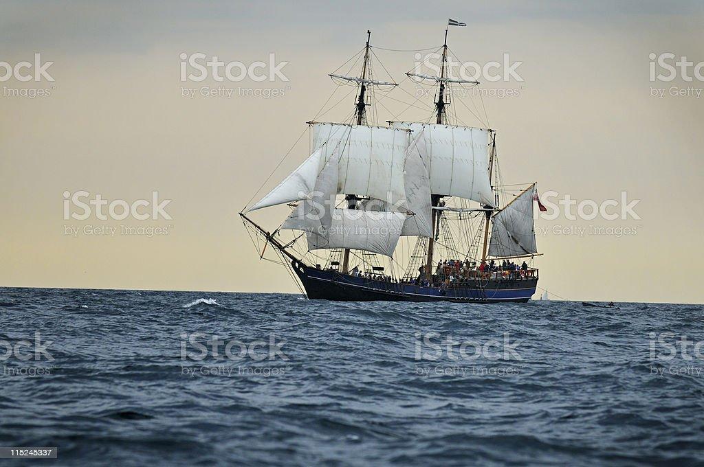 Tall ship sailing into sunset, Cornwall - UK stock photo