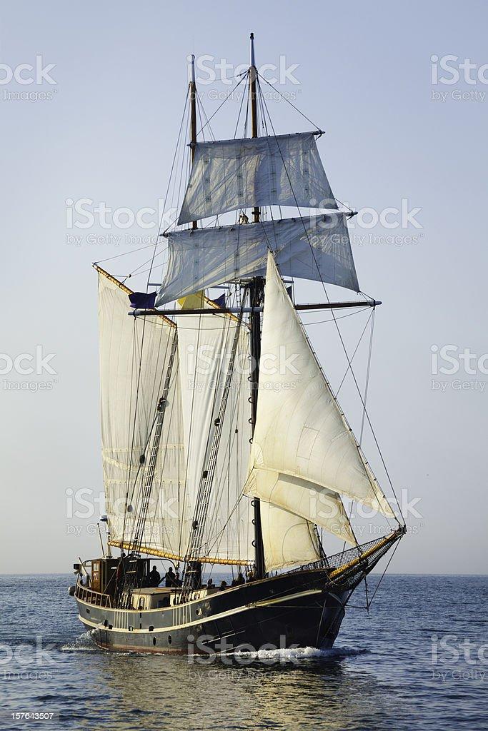 Tall Ship Sailing Open Seas at Morning stock photo