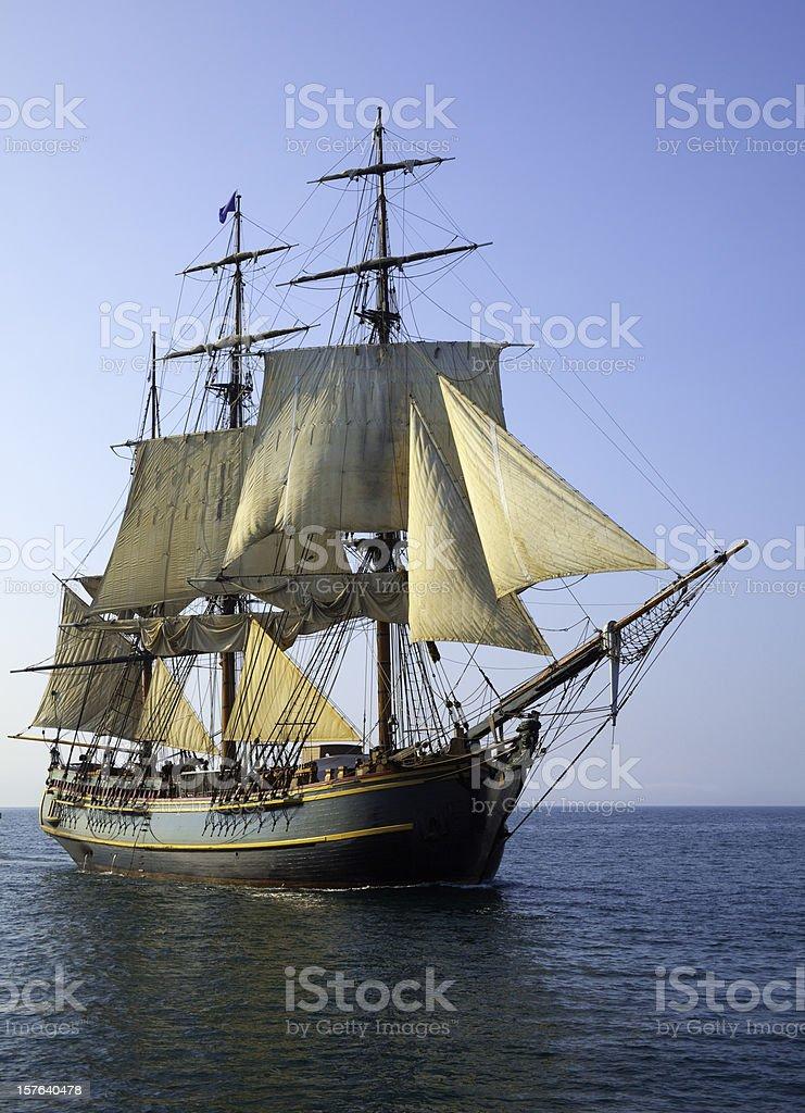 Tall Ship Sailing Open Seas on Sunny Morning stock photo
