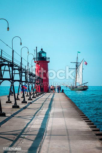 177362898 istock photo Tall ship sailing past a light house on a summer day in South Haven Michigan 1223240855