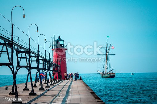 177362898 istock photo Tall ship sailing past a light house on a summer day 1223242158