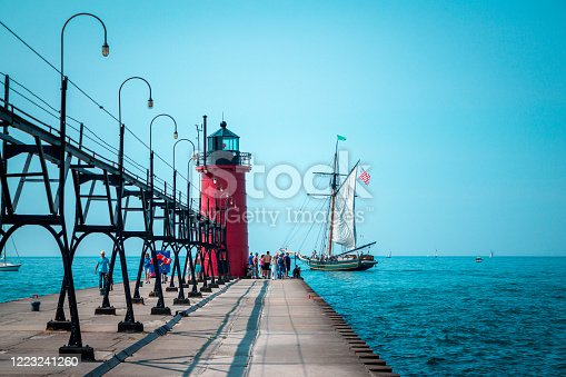 177362898 istock photo Tall ship sailing past a lighthouse on a summer day in South Haven 1223241260
