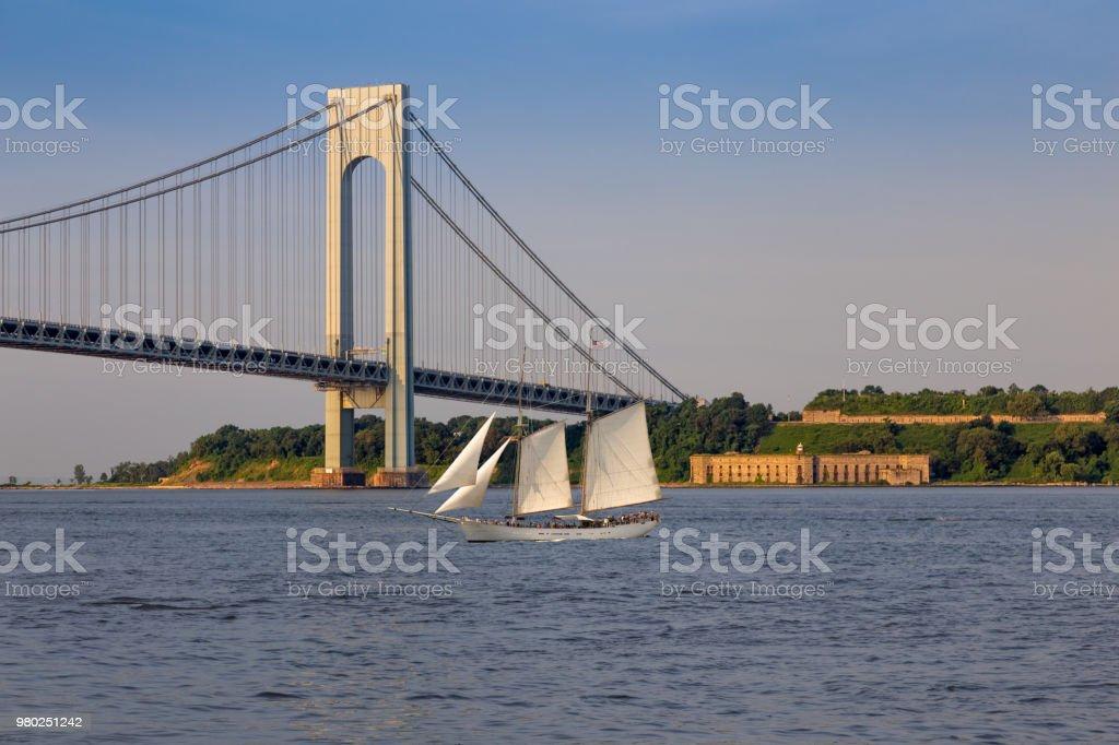 Tall Ship (Sailboat), Verrazano-Narrows Bridge and Fort Wadsworth in the Morning, New York. stock photo