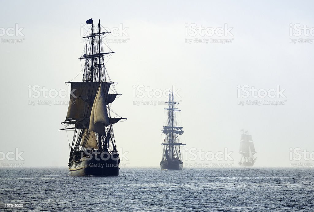Tall Ships in the Last Mists of Morning Fog stock photo