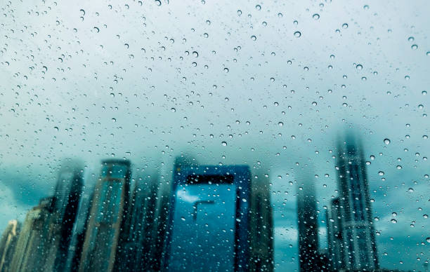 Tall Skyscrapers of Dubai seen through wind shield during a rainy day stock photo