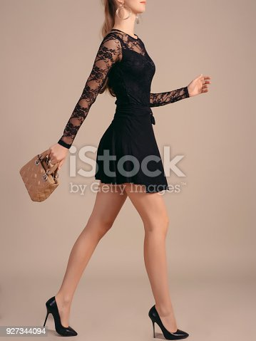 A Tall Slender Girl In A Little Black Dress With Short Fashion
