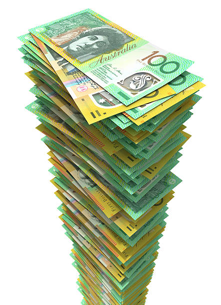 Tall stack of Australian currency on white background stock photo
