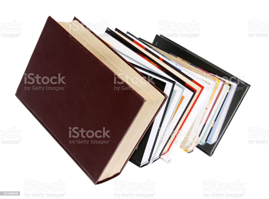 Tall stack of books on a white background royalty-free stock photo