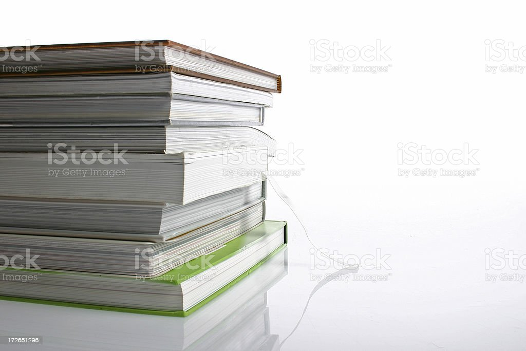 Tall stack of books with reflection beneath royalty-free stock photo