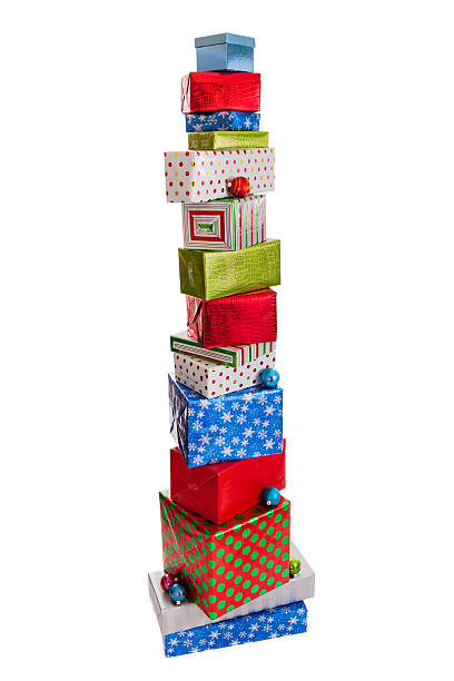Tall stack of Christmas presents isolated on white stock photo