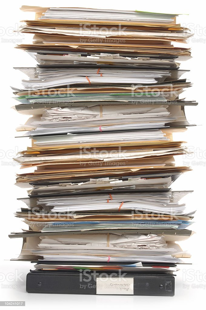 Tall stack of documents in folders and binders stock photo