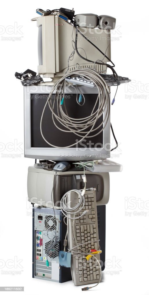 Tall stack of electronic waste on white background stock photo