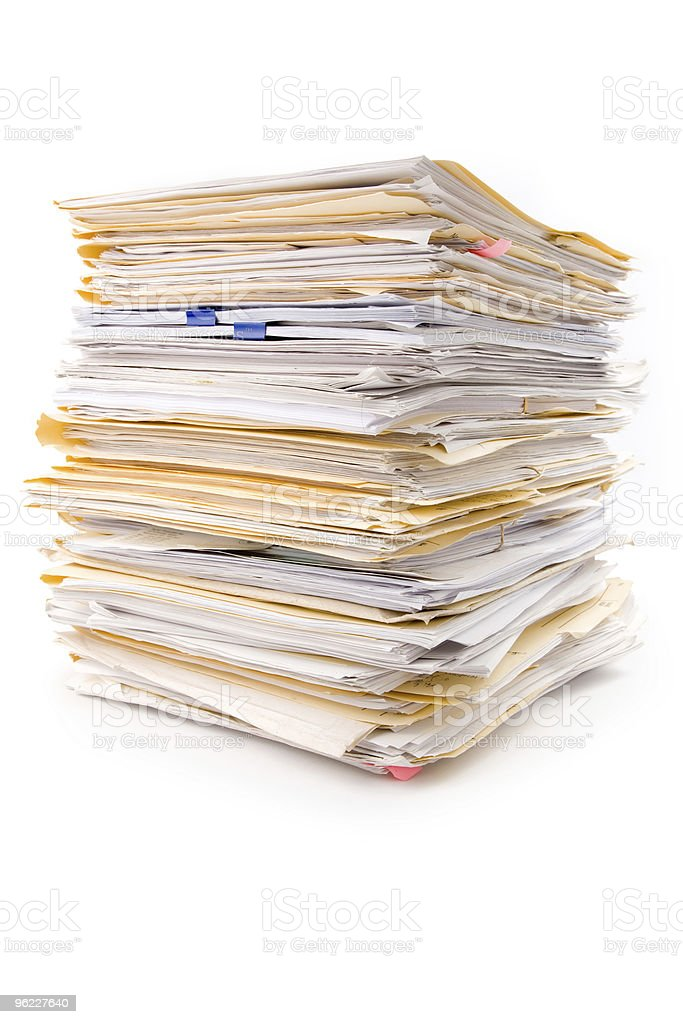 Tall stack of files and paperwork stock photo