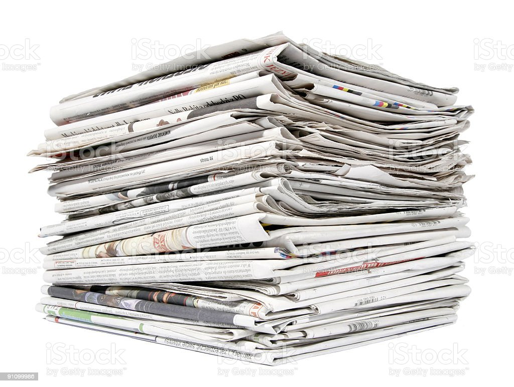 Tall stack of folded newspapers against a white background royalty-free stock photo